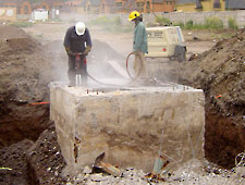 massive reinforced concrete being drilled before bustar grout breaks the concrete